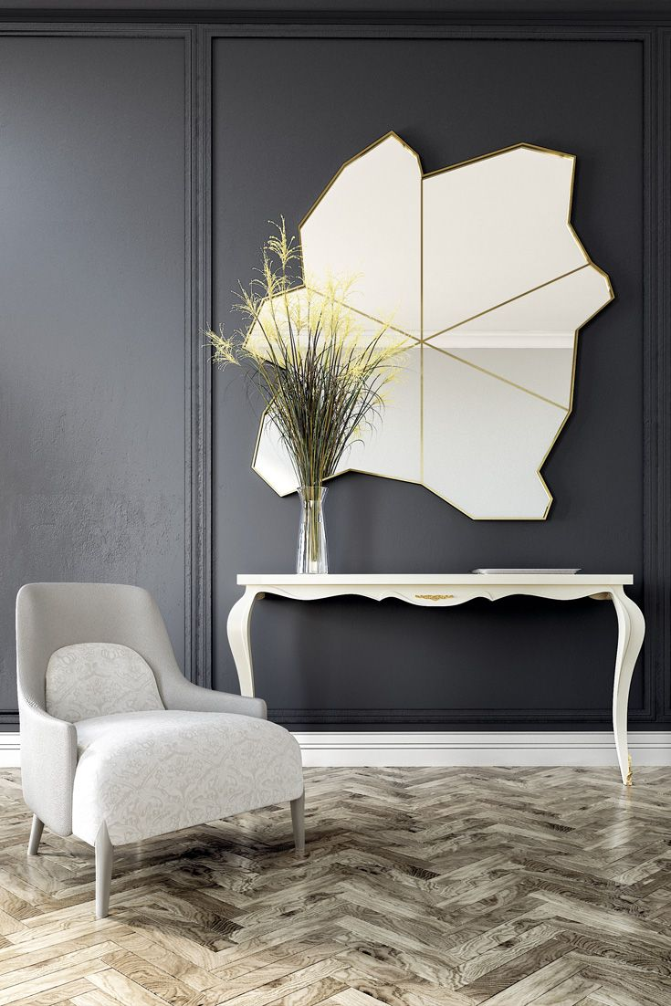 For versatility this fabulous modern mirror is available in two sizes as standard. The Exclusive Unique Modern Gold Wall Mirror offers a superbly creative design that is both functional and unique and an exciting innovative focus along with light and space. The unusually shaped slim frame is finished with gold leaf together with a gold diagonal design which strikes through to the centre of the mirror drawing the eye in. Find a fine selection of statement luxury mirrors at Juliettes…