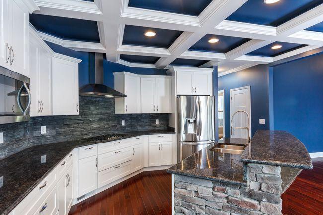 blue and white coffered ceiling, stone island, white cabinets, slate backsplash, MSI Steel Grey granite countertops, Pacific Mahogany chestnut hardwood floor. The paint is Benjamin Moore Van Deusen Blue.