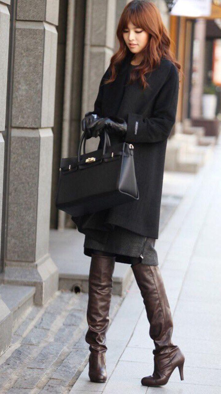 Asian girl in high boots amusing