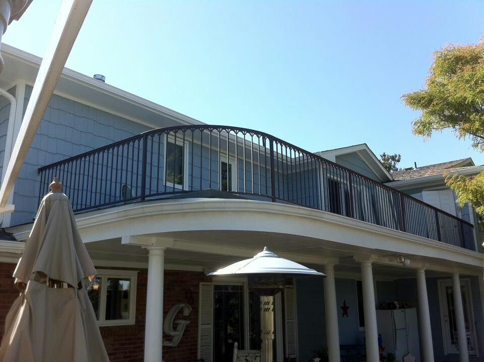 Solid bar deck railings with scroll top cap. Fab ...