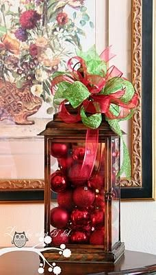 Love this lantern with Christmas Balls. What a fun way to decorate for the holidays something that is already out.