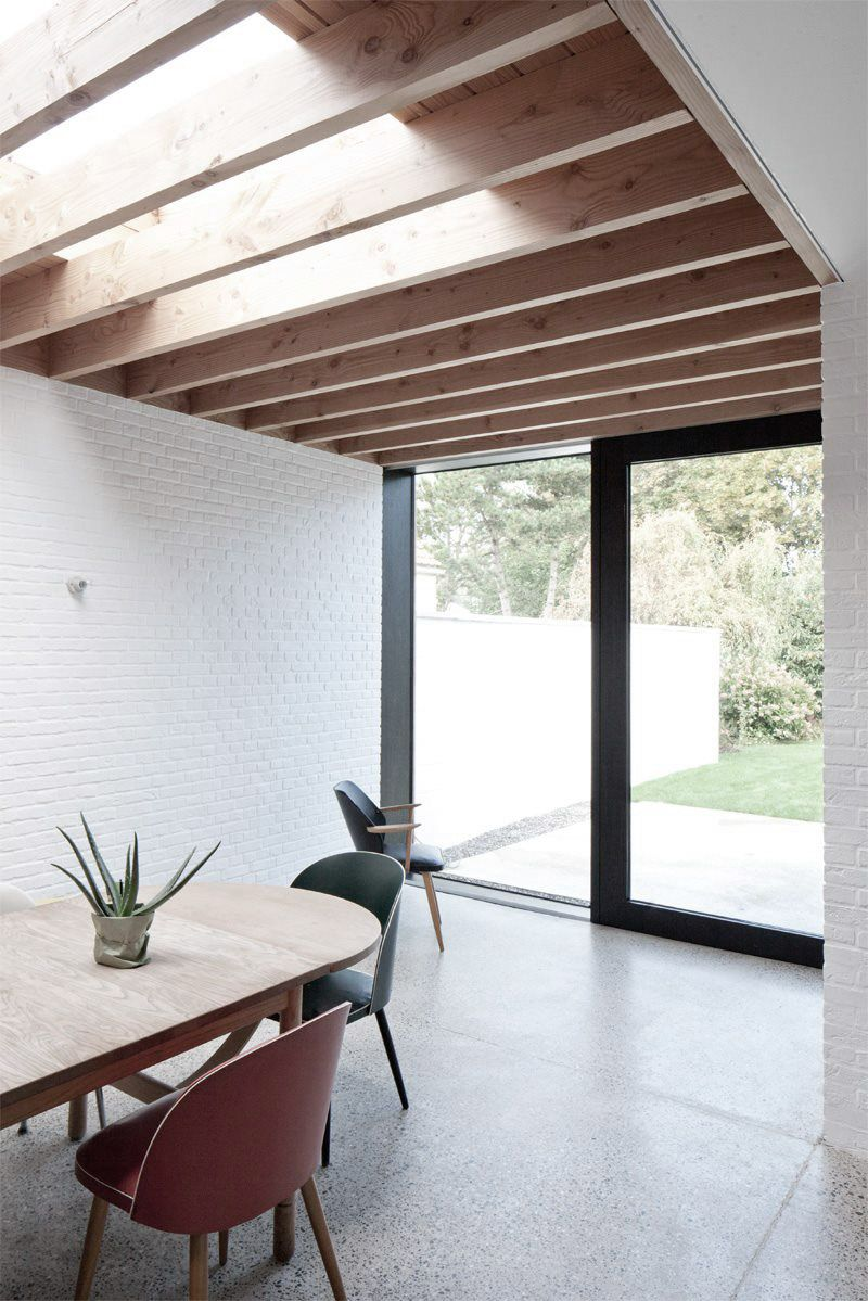 Modern extension refurbishment cedar beams white brick wall add warmth by rolies dubois