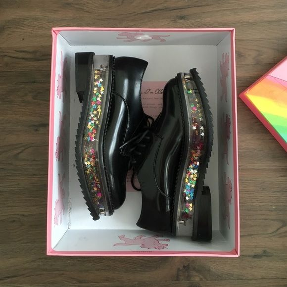 Jeffrey Campbell Jagger platform Oxford Size 7 super cute hardly worn platform Oxford. Platform sole is filled with rainbow colored pieces of glitter and stars. Bottom treads are rubber and very durable. Jeffrey Campbell Shoes Platforms