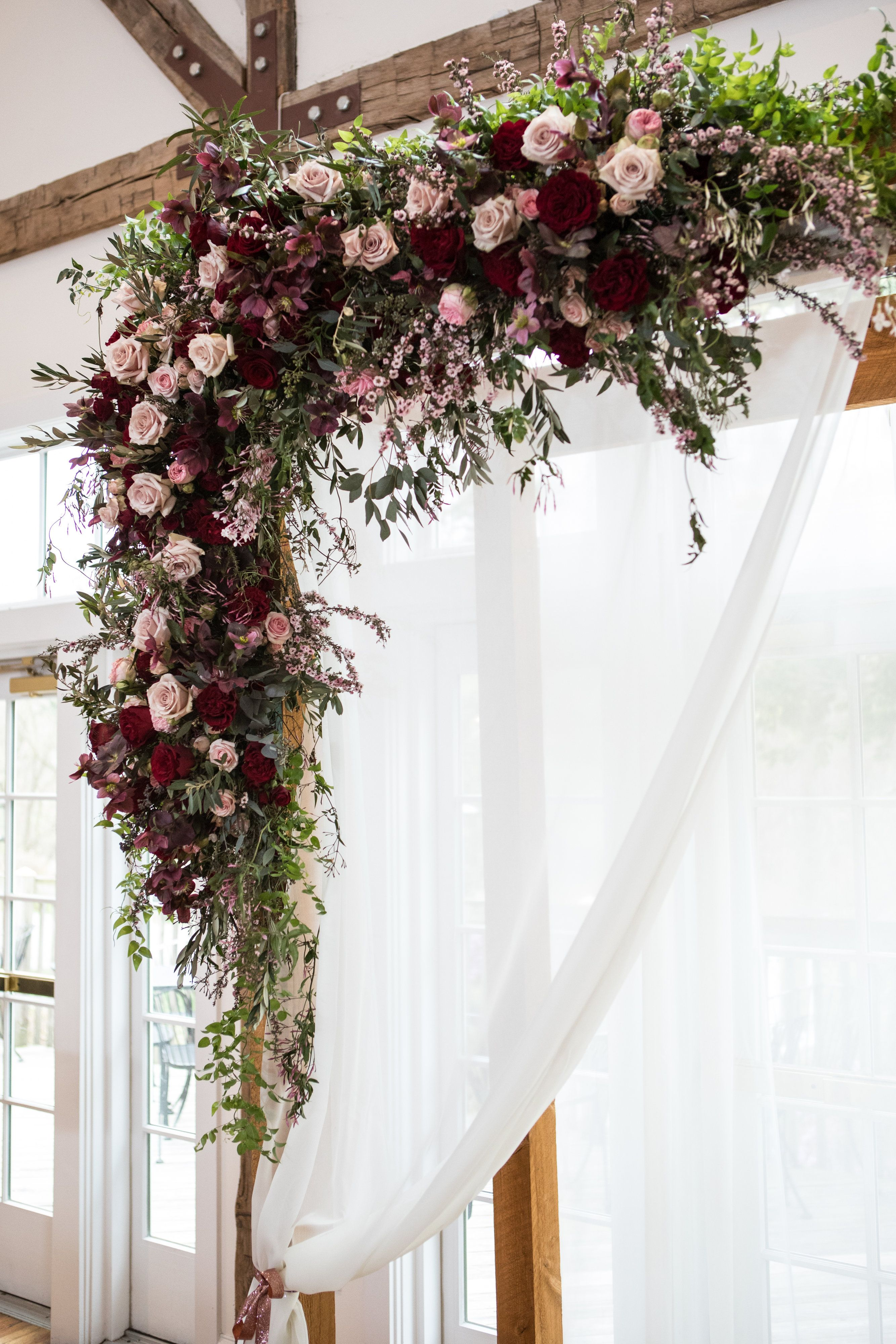 A stunning floral altar for a bordeaux themed wedding. Creative and ...