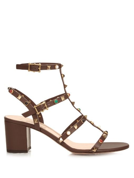 Valentino's new series of Rockstud Rolling sandals has an opulent feel.  This dark-brown smooth leather pair is shaped with a cage-like T-bar front,  ...