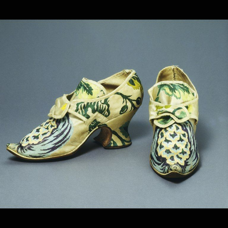 """Brocaded Spitalfields silk uppers """"The passion for wearing silks spread to women's shoes in the 18th Century. Until the 1790s, very little leather was used for women's footwear, except boots for outdoors. The curved heel and pointed up-turned toe of this shoe are typical of women's shoes in this period."""" V&A"""