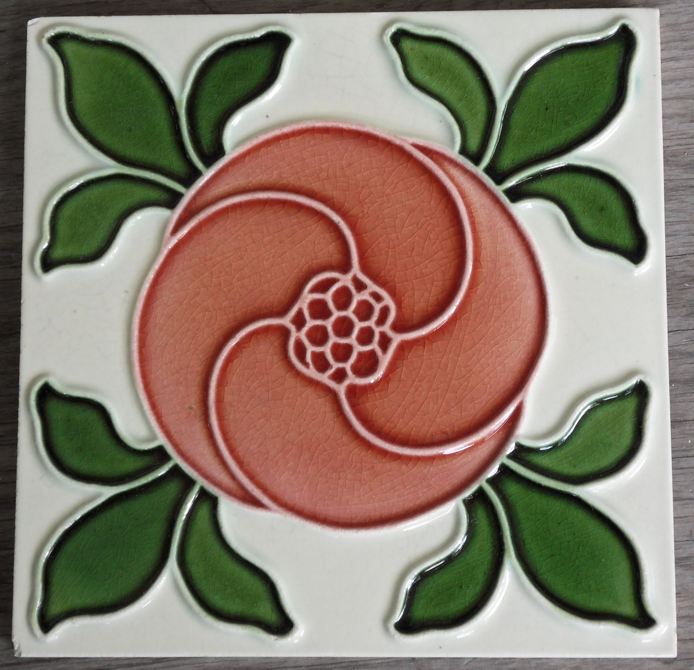 Fills the tile with organic content a super relief moulded design from Maws c1906