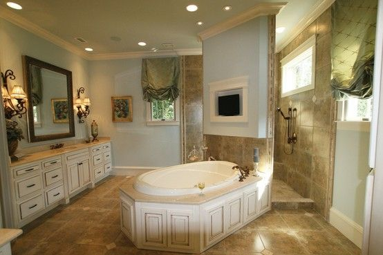 Large Tub In The Center Of The Room With A Walk Through Oversized