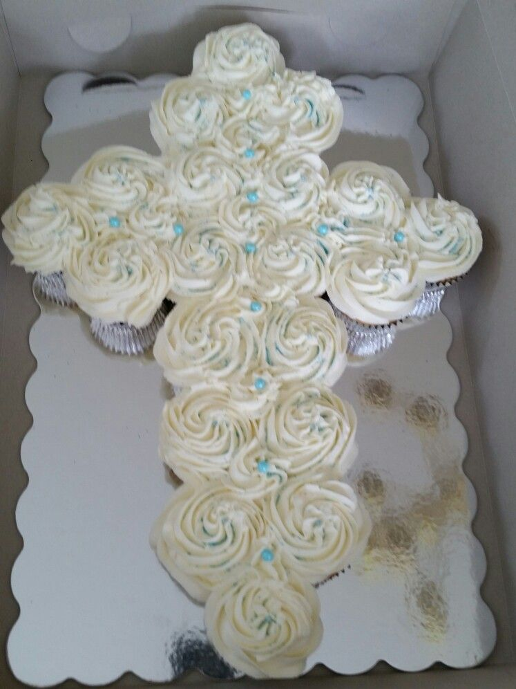 Cross cake with buttercream icing for a boy.