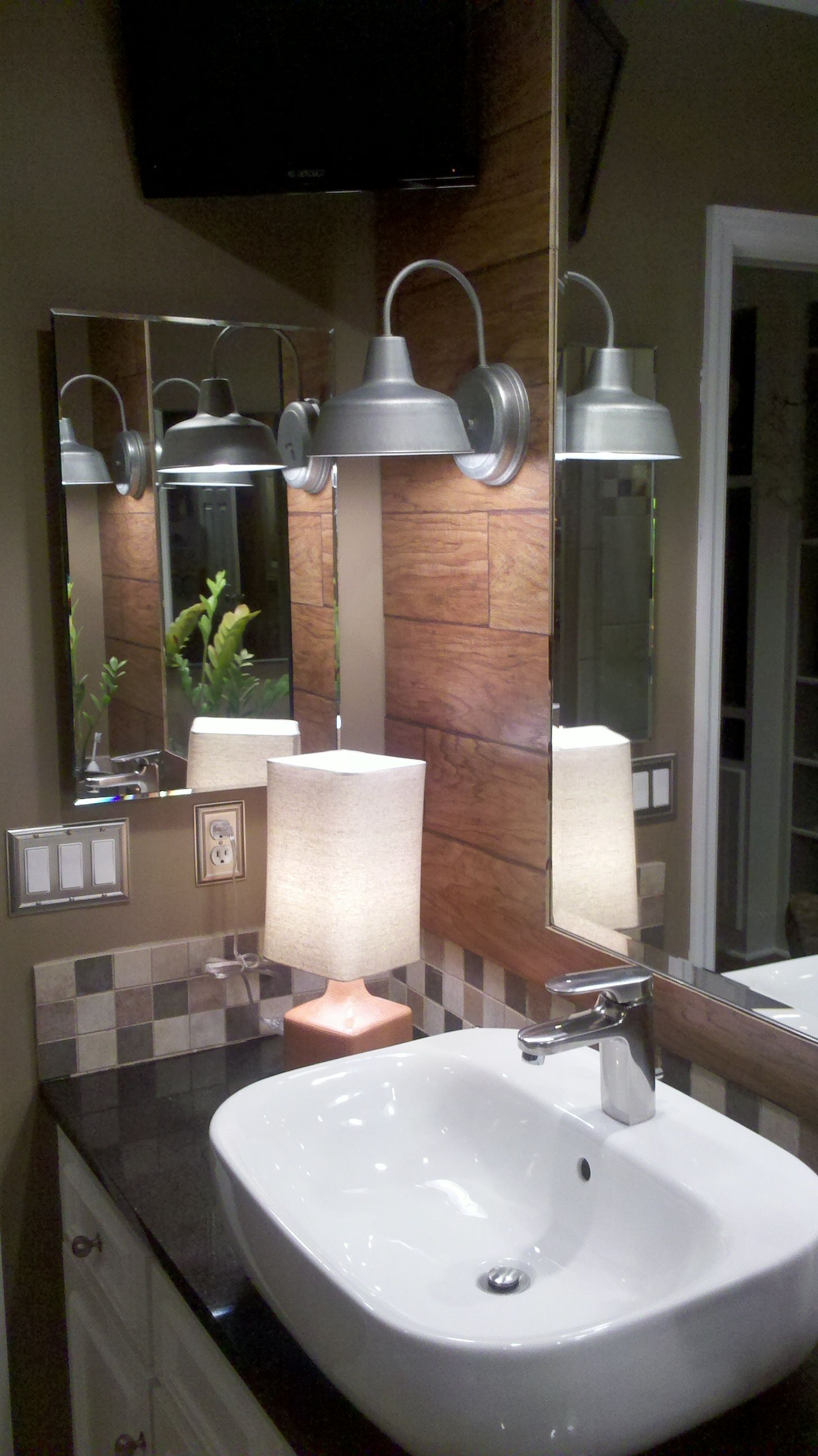 use left over wood flooring on the walls of your bathroom
