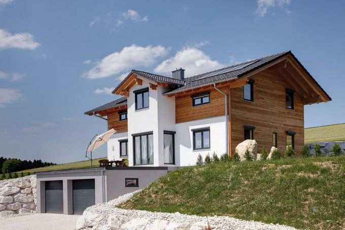 Photo of Tradition in modern – solid wood house by Sonnleitner   House & construction