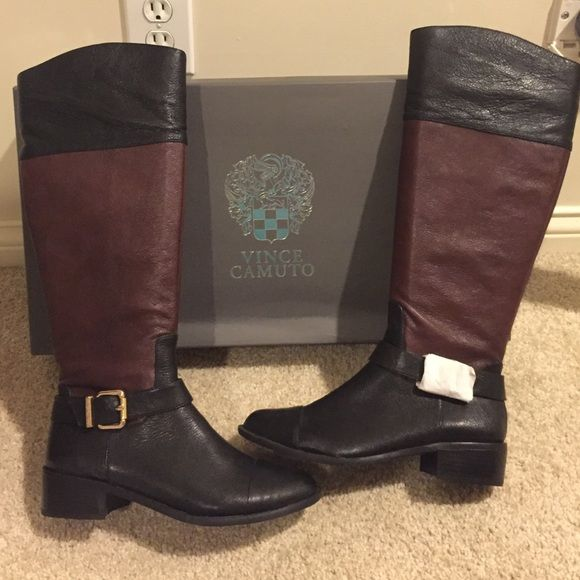 Vince Camuto black/chestnut riding boots size 8.5. Vince Camuto tall black/chestnut venice  leather riding boots size 8.5. Never been worn and still have the box. In perfect condition with zero imperfections. Roughly 1 to 1 1/2 inch heel. Open to reasonable offers! Vince Camuto Shoes Heeled Boots