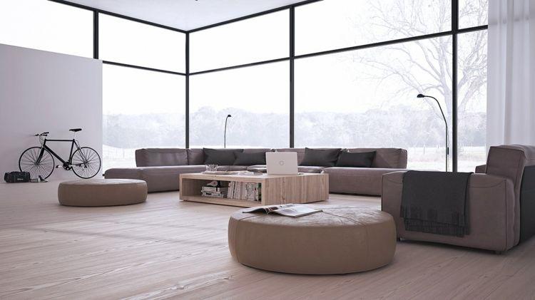 Niedrige Möbeln in Beige in einem minimalistischen Wohnzimmer