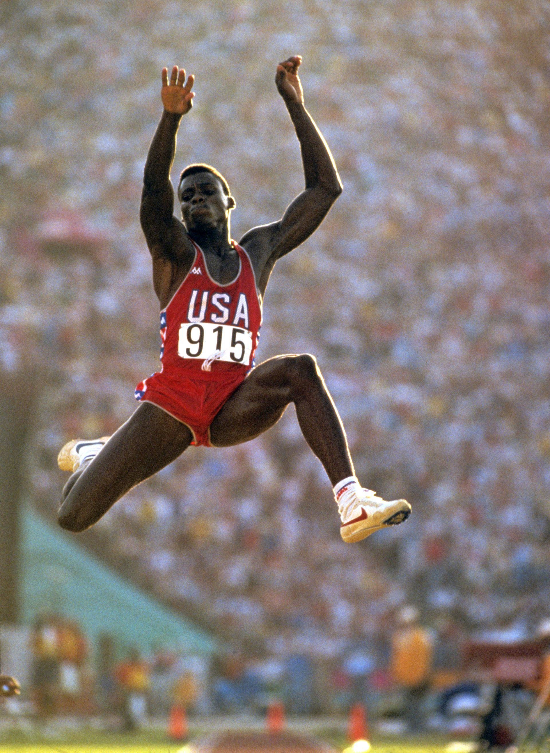 Carl Lewis, Long Jump Gold Medalist | Neil Leifer | Carl lewis, Sports  photography, Long jump
