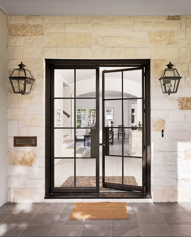 Black Steel Front Door Entry With Stone Walls And