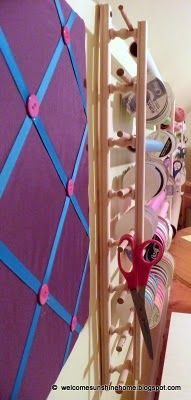 Want to make your own organizer wall?  It's super easy!  To make one exactly like this here's what you'll need: - Empty wall space that's about 10 feet wide and at least 2 feet tall - (2) 4ft long decorative accent railing (16 little spindles on each piece) - (8) 4ft long dowels - (16) 3ft long dowels - (8) anchors and screws - Drill - Mitre saw, mitre box, or jig saw - Level - Pretty papers and ribbons galore!
