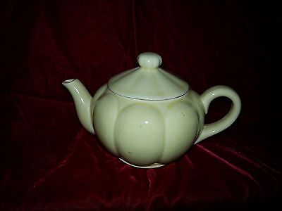 Vintage yellow porcelain teapot with lid