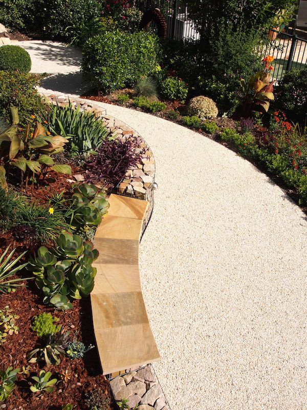 The Seating Wall Section Topped With Sandstone Pencil Round Pavers