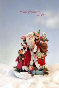 Beautifully modelled Christmas cake by Neli of CakesDecor.
