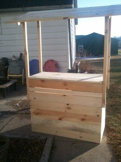 Elle's lemonade stand... or Tiki bar for the adults... multi functional.old pallet wood.