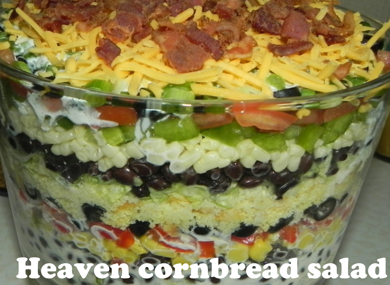 The ingredients:        1 (16 ounce) package corn bread mix      1 1/2 cups sour cream      1 1/2 cups mayonnaise      10 slices baco...
