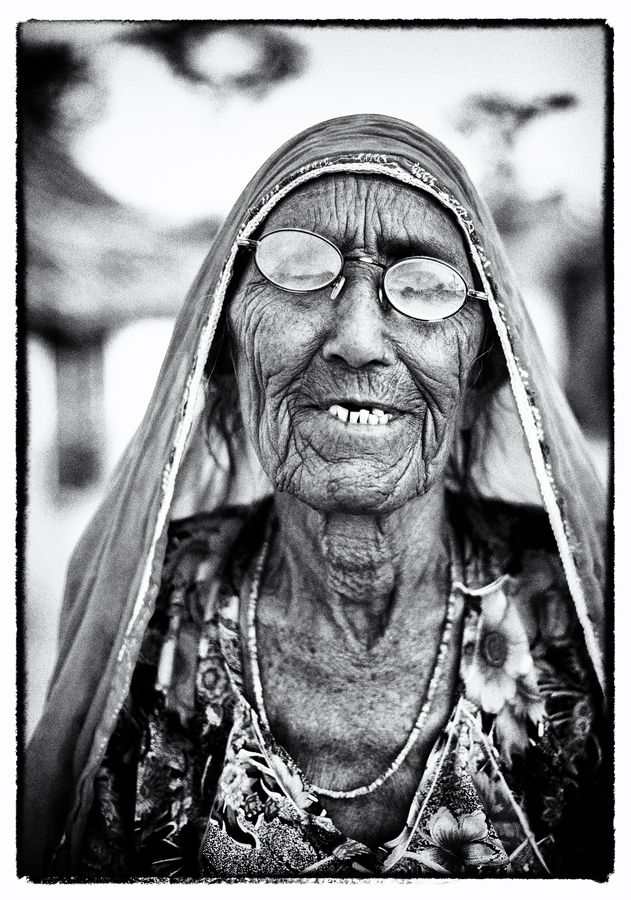 And she smiles.. old lady, glasses, female, lines of life, wrinckles, beauty, priceless, great face, portrait, photo b/w.