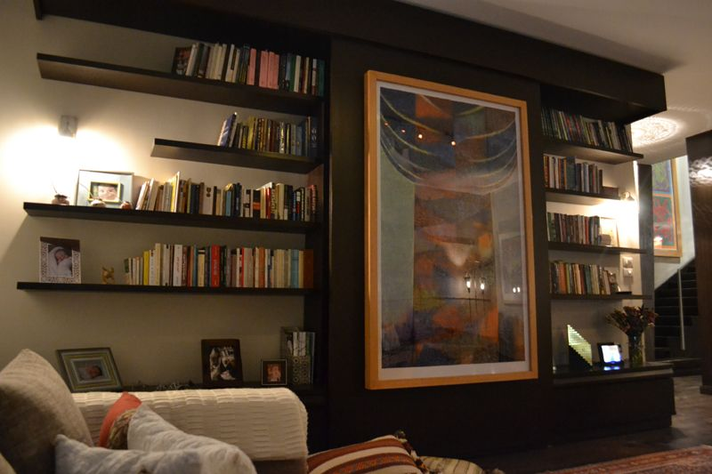 DAR ARAFA Interior (2008-2009)  A multi-purpose unit designed to host books on its shelves, dvds in its drawers but most importantly to make the home entertainment screen less dominant allowing better social interaction.  Designed by Architect Waleed Arafa  of Dar Arafa Architecture in collaboration with Interior Designer Nisreen Moustafa of Nuun Interiors.