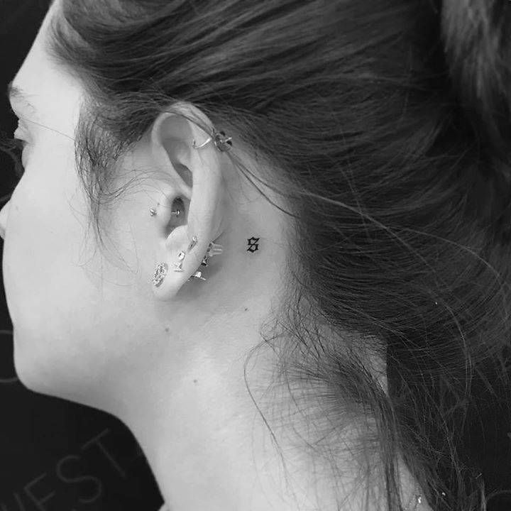 Small Old English Tattoo: Old English Style S Tattoo Behind The Left Ear.