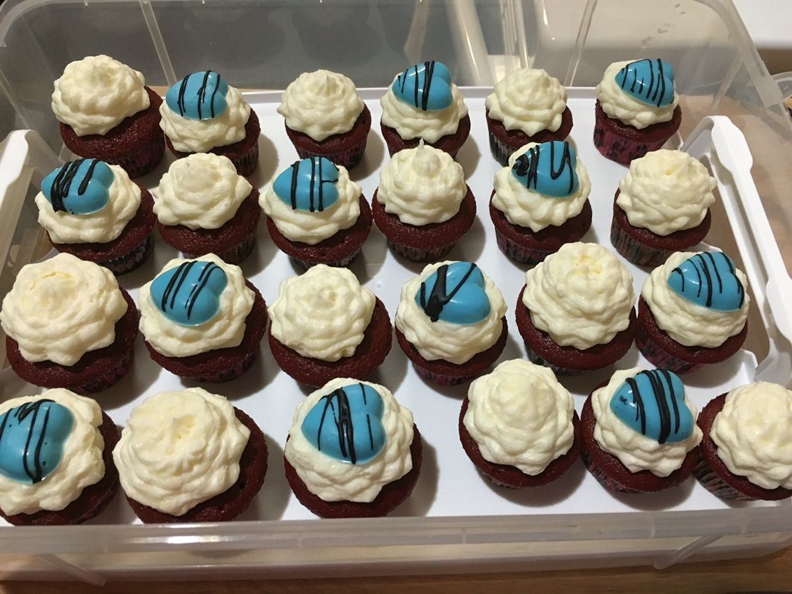 Red velvet mini cupcakes from a box mix, from scratch butter and cream cheese frosting, with candies molded at home.