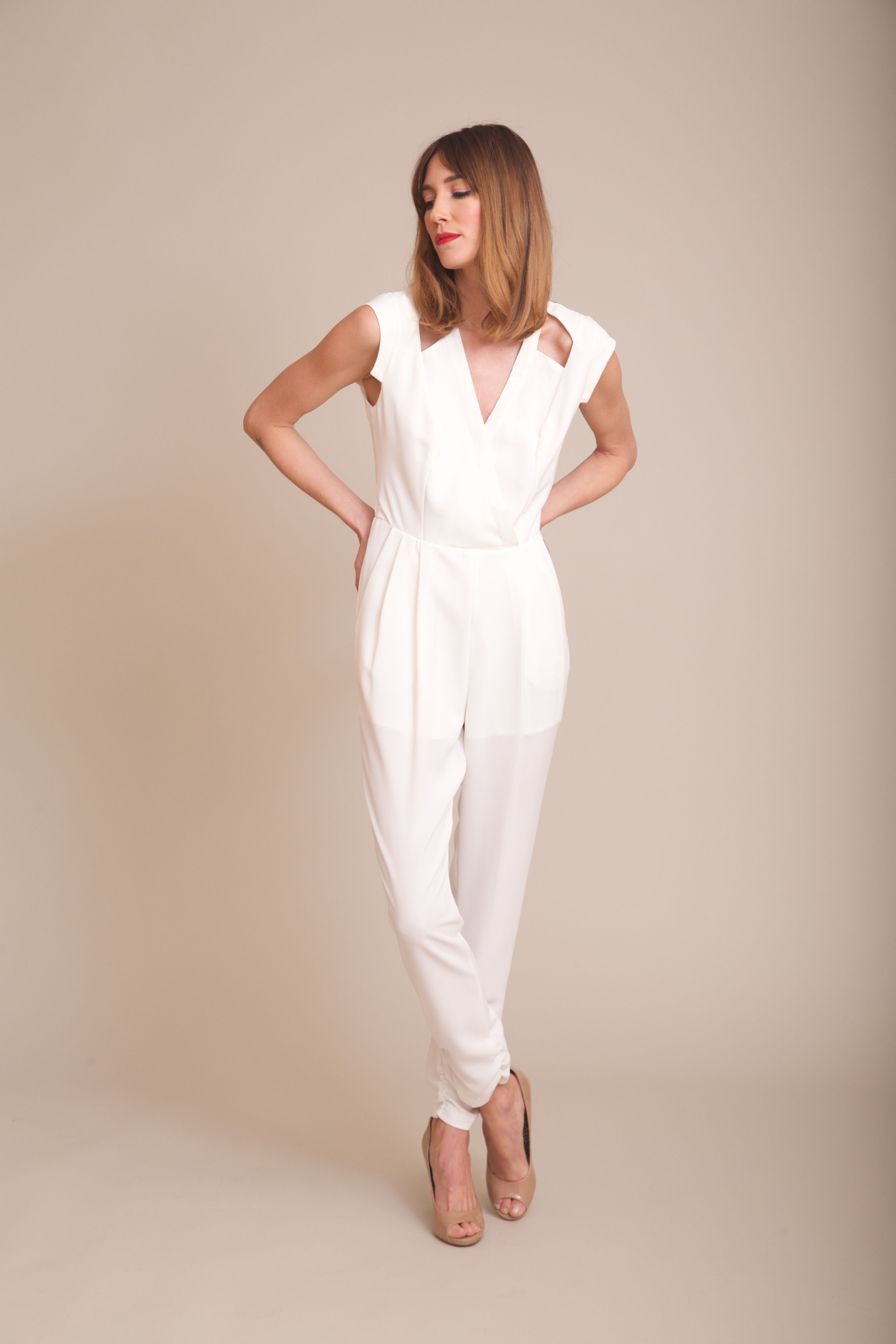 79f05e56b594 the perfect  weddingjumpsuit for the non-traditional bride on  www.shoplovely.com Photo courtesy of Brooke   Sam Photography.