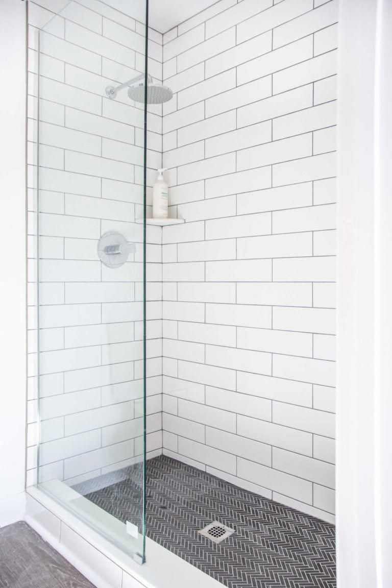 Master bathroom shower tile renovation with grey herringbone mosaic and white subway tile on Thou Swell
