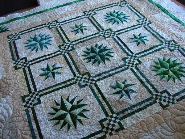 Yvonne's Emerald Starz...Quilted by Charisma quiltingboard The pattern's real name is Maritime. It was designed by Judy Martin, and the pattern appears in her book, Stellar Quilts.