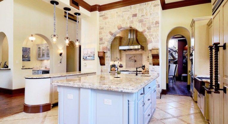 Incredible Mediterranean kitchen with stonework around the over