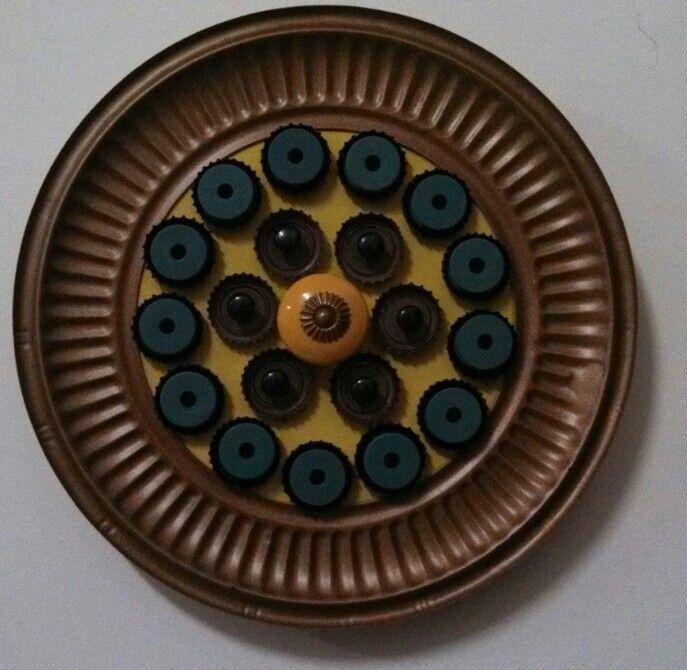 Green Mixed Media Flower by Jennifer Nichols. Metal, wood, plastic, paint, ceramic. SOLD