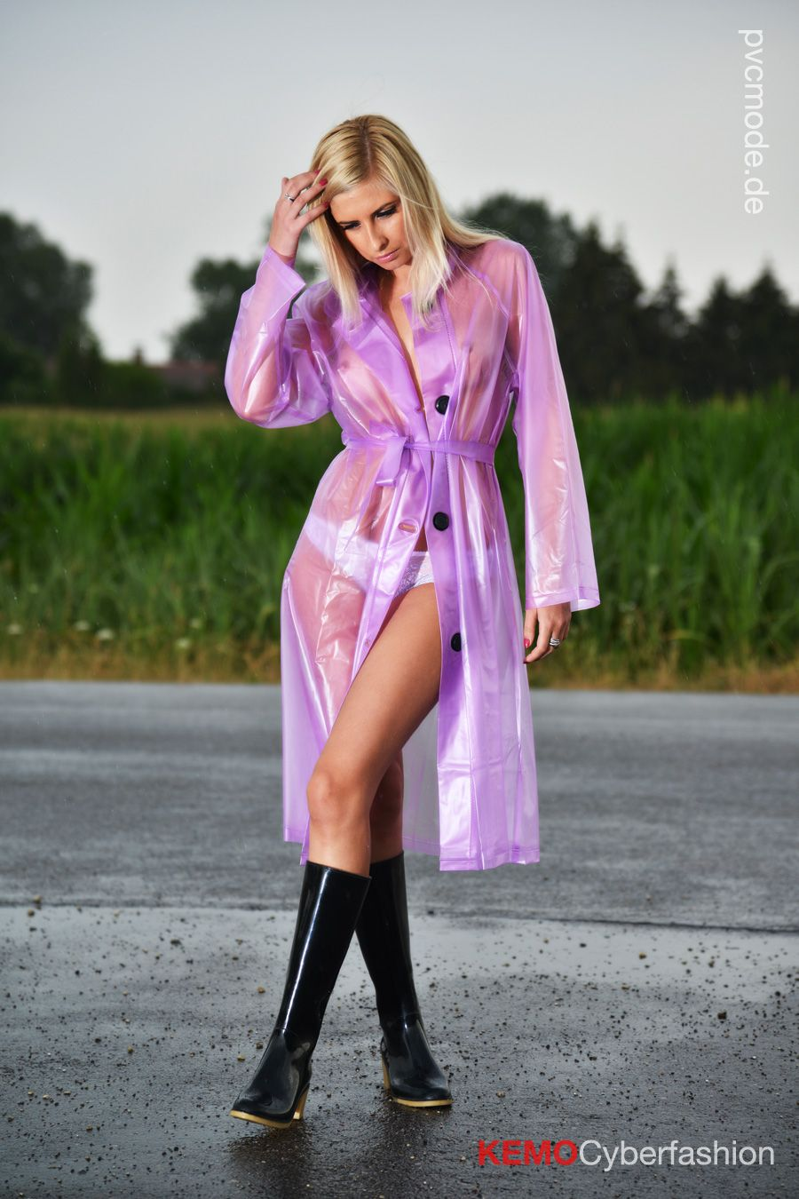 Sexy Girl Dressed In A Transparent Lilac Pvc Raincoat From