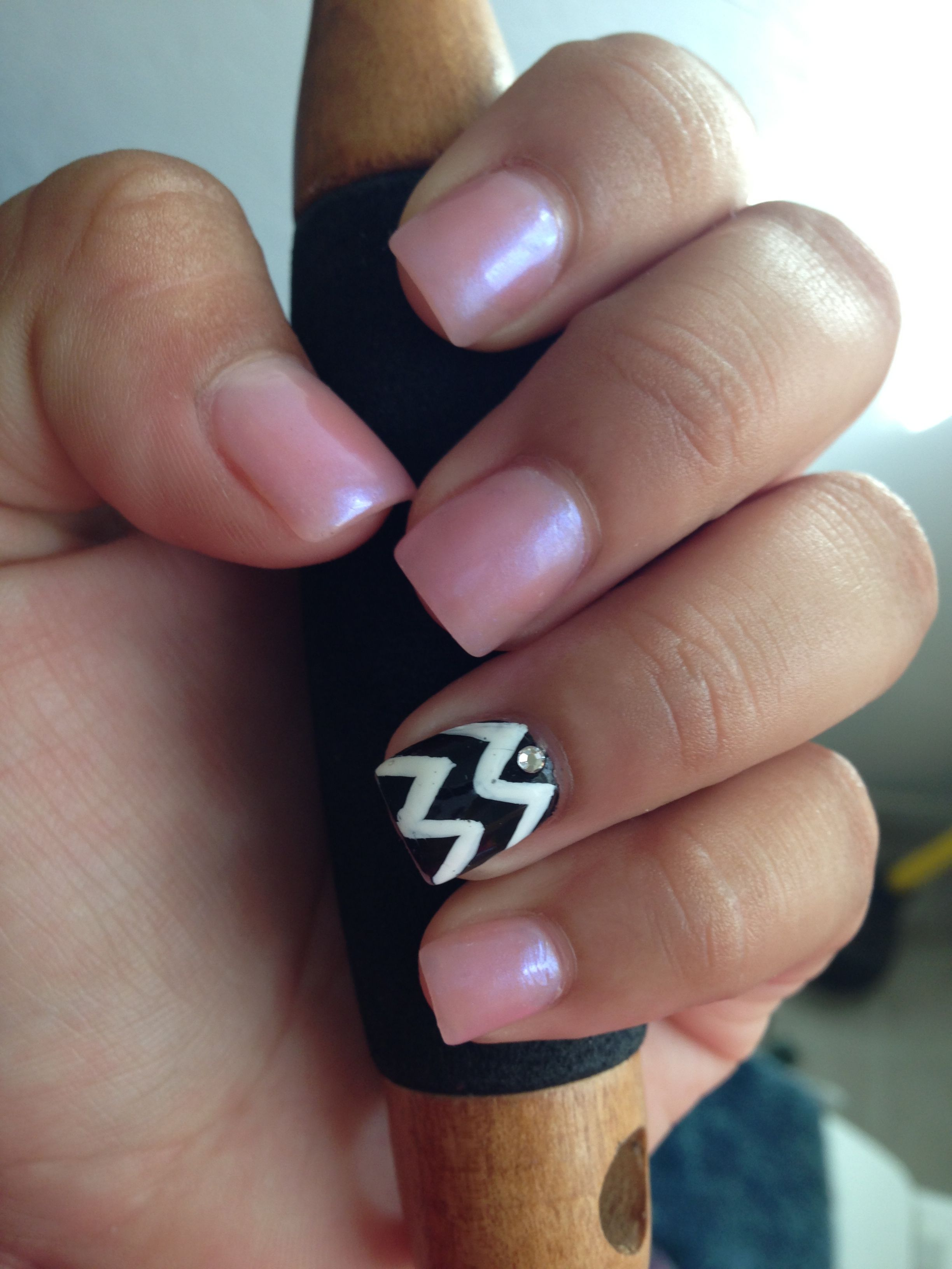 Short pink cotton candy nails with black and white nail design