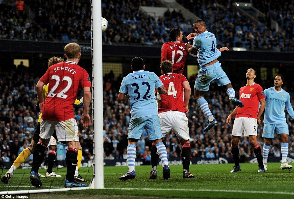 Vincent Kompany heads into the net as City beat United 10