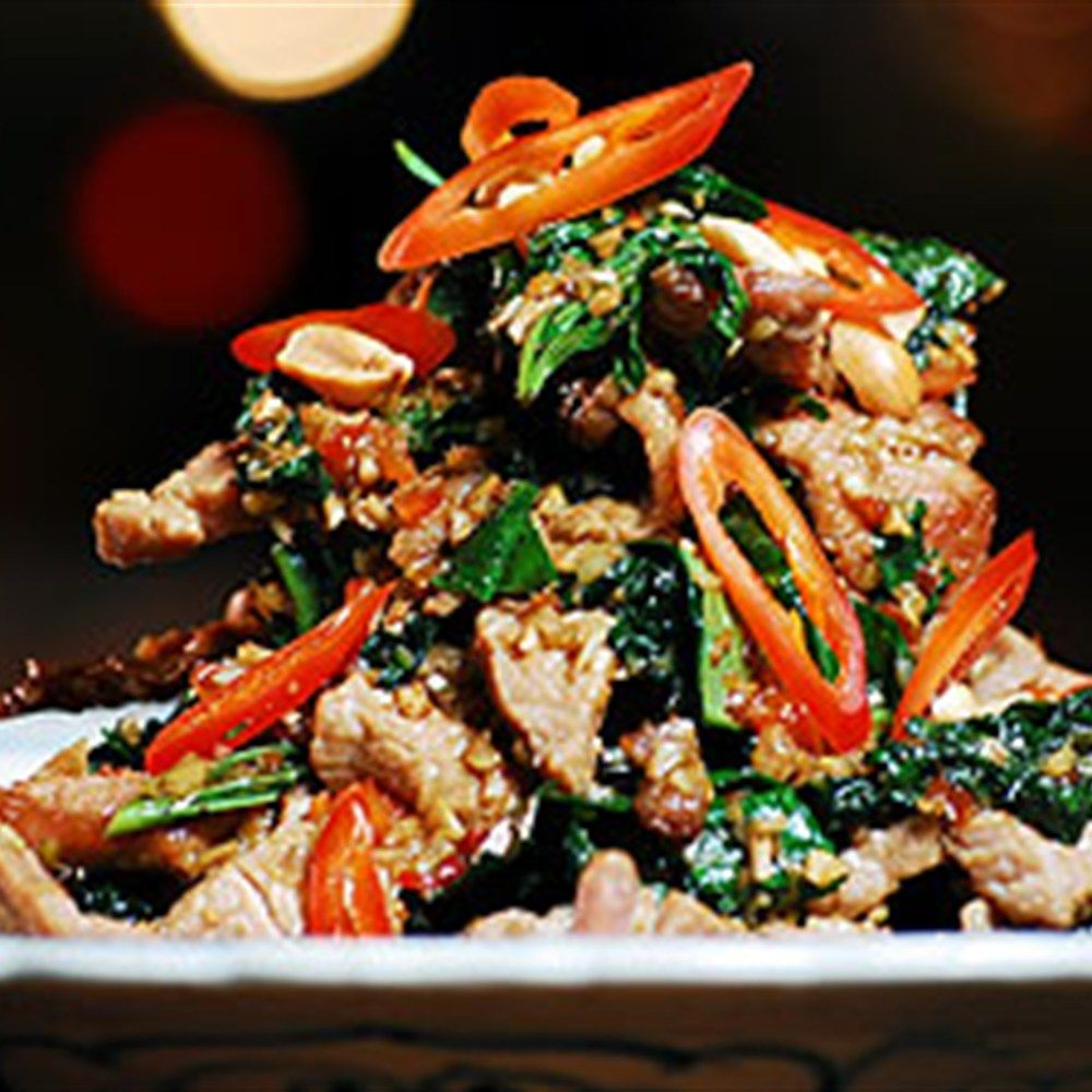 Try this Beef Tossed with Wild Betel Leaf and Lemongrass - Bo Xao La Lot recipe by Chef Luke Nguyen. This recipe is from the show Luke Nguyen's Vietnam.