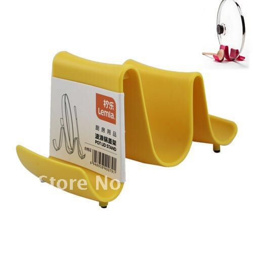 Image from http://i01.i.aliimg.com/wsphoto/v0/606396495/Yellow-Pot-Lid-Cooking-Spoon-Stand-Holder-with-Novelty-Design-Kitchen-Accessories-54481.jpg.