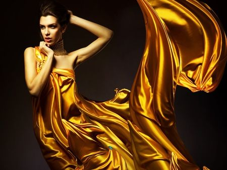 Draped in gold .