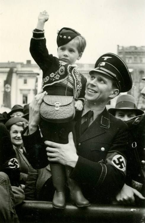 An SS officer with his son. Teaching kids to hate