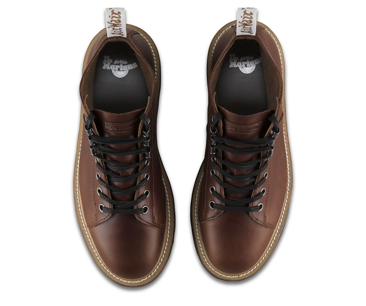 The Lesley Boot takes the classic Dr. Martens 7-eye boot silhouette, and makes it clean, feminine and modern. A lightweight, contrast sole, a subtle wedge heel and three hiking-inspired tunnel loops. Made with premium Analine leather, this elegant boot serves up classic Doc's DNA, like stitching and a heel loop — but in white.