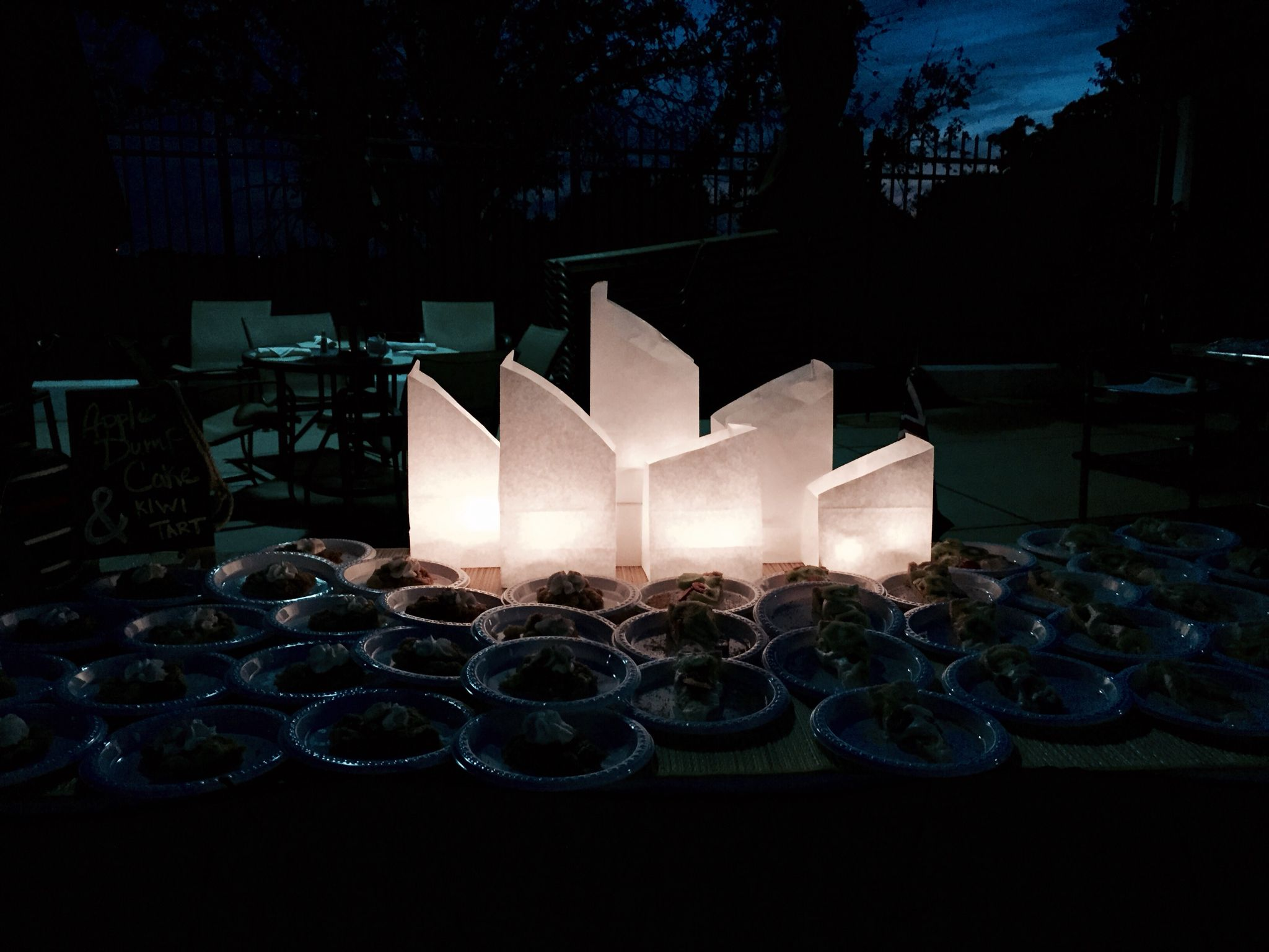 Australian outback theme party buffet...Sydney opera house with paper bag luminaries