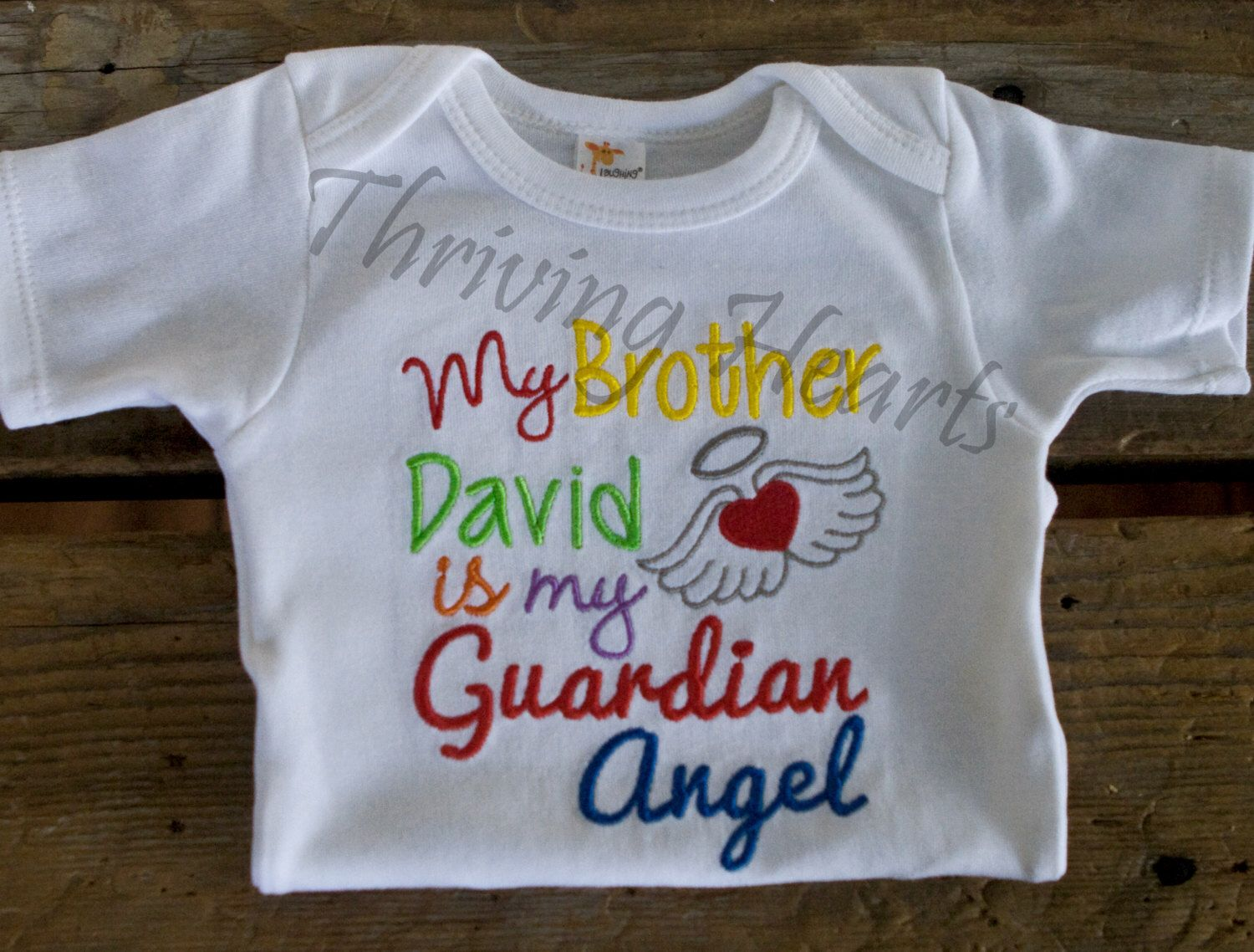 My brother is my guardian angel. Rainbow baby onesie.