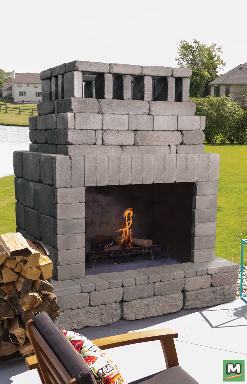 This Rhode Island Outdoor Fireplace May Be Small In Size But It Provides Plenty Of Heat Build O Outdoor Fireplace Plans Building A Deck Outdoor Patio Designs