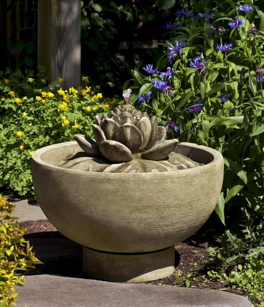 A round basin centered with a beautiful lotus flower makes the a round basin centered with a beautiful lotus flower makes the smithsonian lotus fountain a beautiful dhlflorist Images