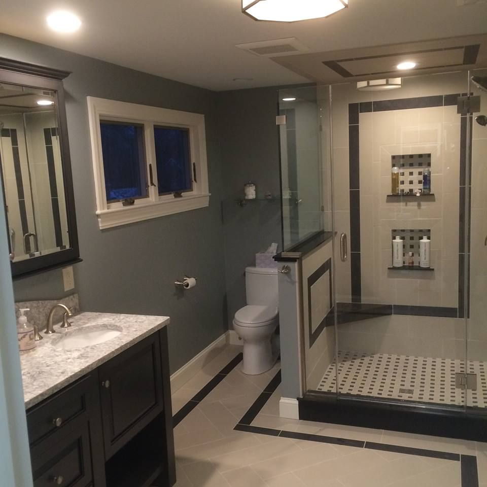 Viatera Countertop Aucet And Shower System In Satin Nickel Satin  Nickel.Porcelain Tiled Glass Enclosed Shower With Shower Bench In Corian.