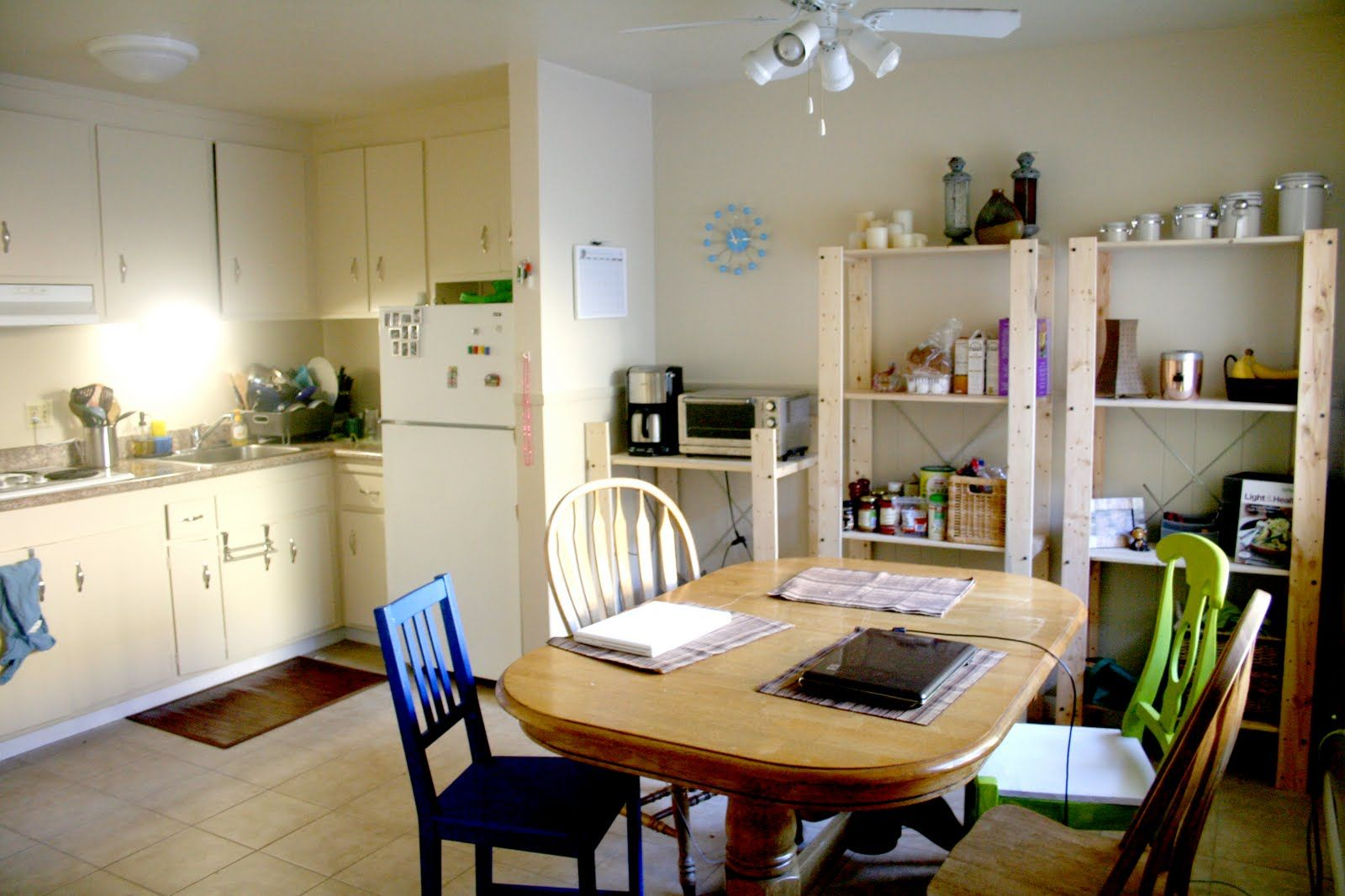 white-medium-plain-apartment-kitchen-combines-wooden-dining-table