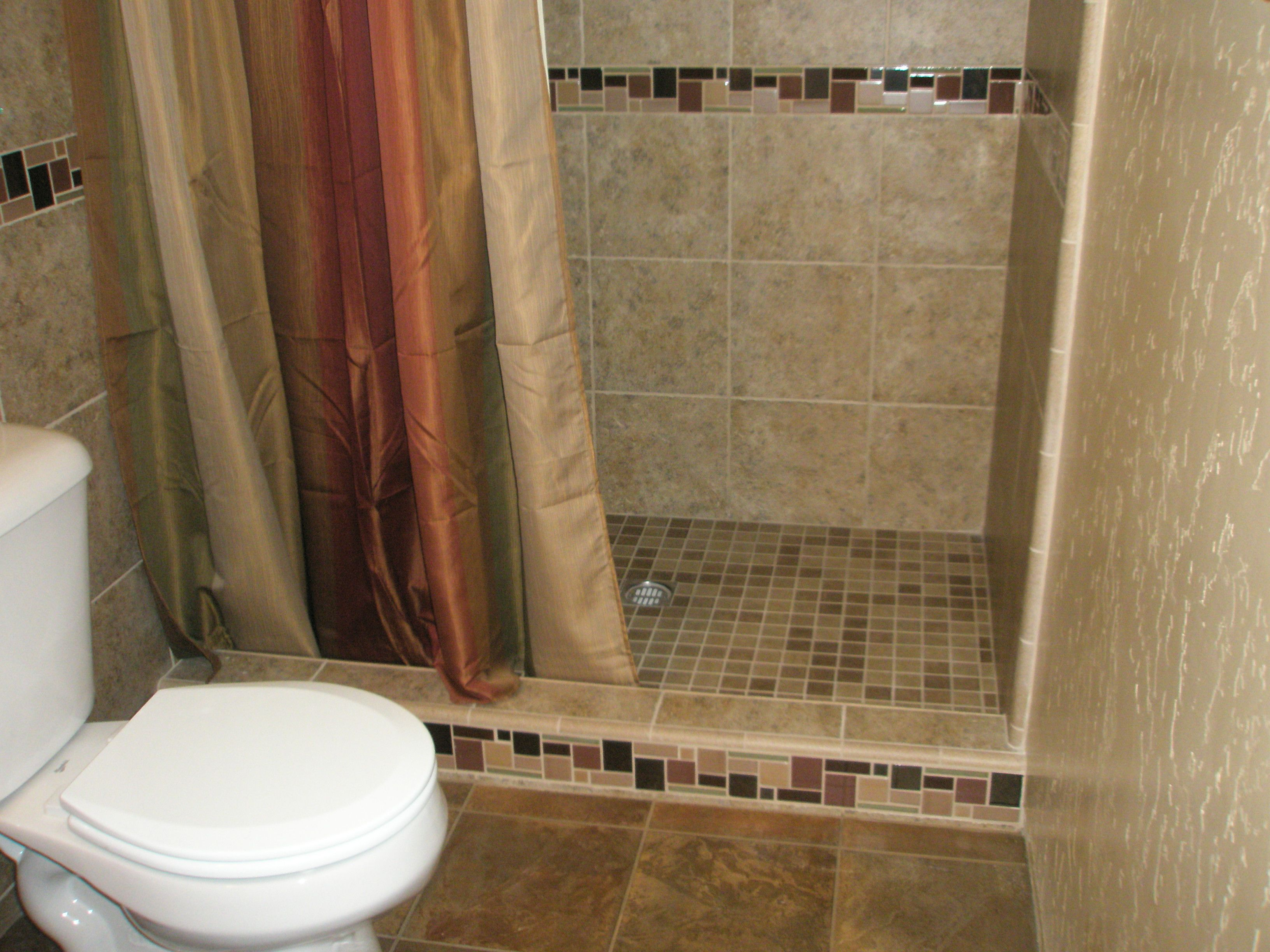 Shower Installed With Ceramic Tile With Accent Border On The Shower