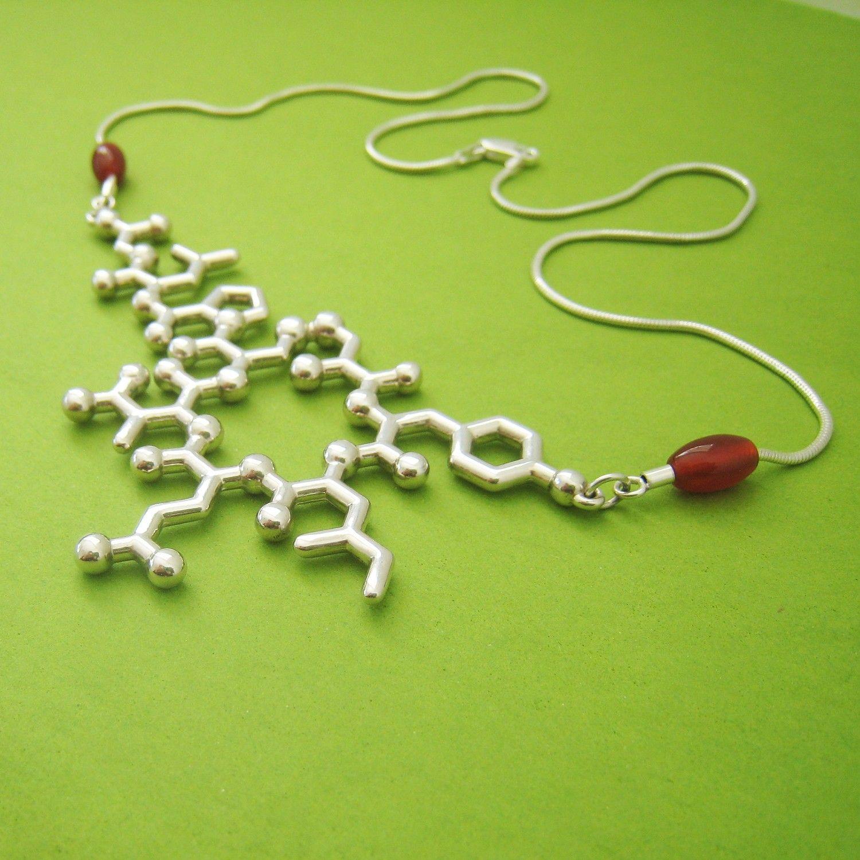 oxytocin molecule necklace - bonding, empathy, and trust. $240.00, via Etsy.
